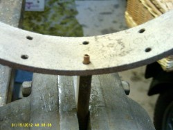 A rivet is placed on the anvil, then the lining followed by the brake shoe.