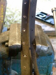 Punch out the old rivets with a nail.