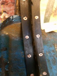 Brake shoes removed and in the vice for the heads of the rivets to be drilled off.