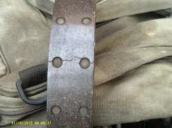 Cracked brake lining.